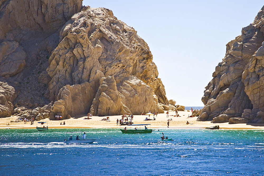 Busy tourism boats in Cabo San Lucas, Baja California Sur, Mexico. The Los Cabos area has grown to over 180,000 inhabitants (2007) in the last 10 years. Development is proceeding unchecked as the area struggles to provide fresh water for the new developme