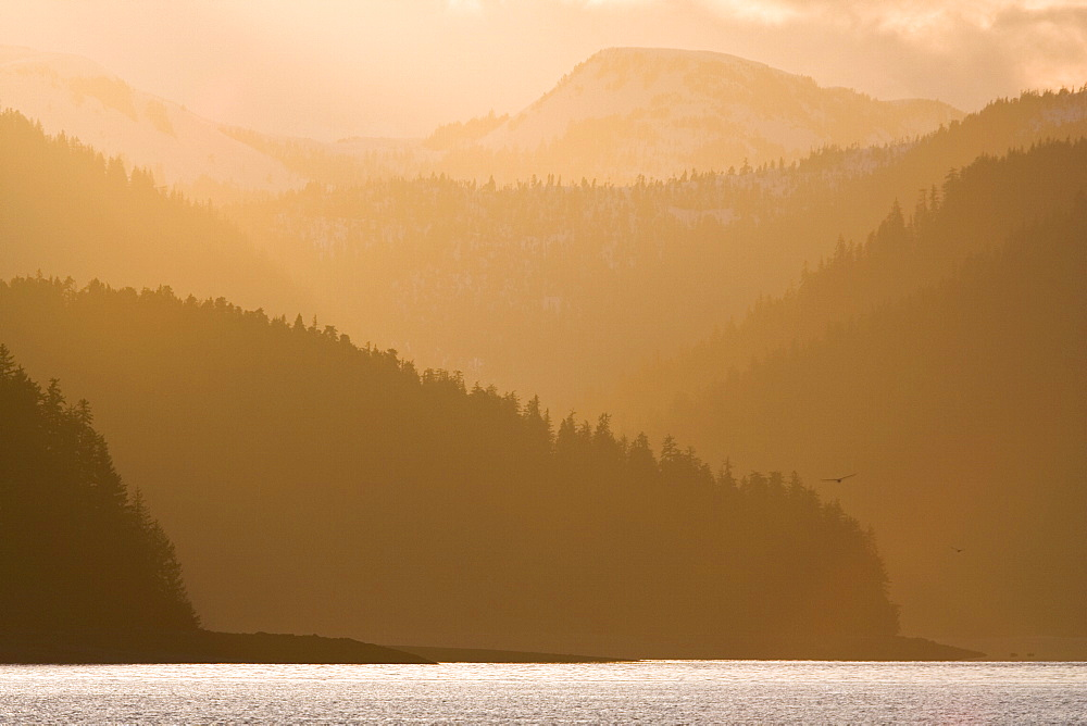 Sunset on Chichagof Island from Peril Strait, Southeast Alaska in the springtime, USA, Pacific Ocean.