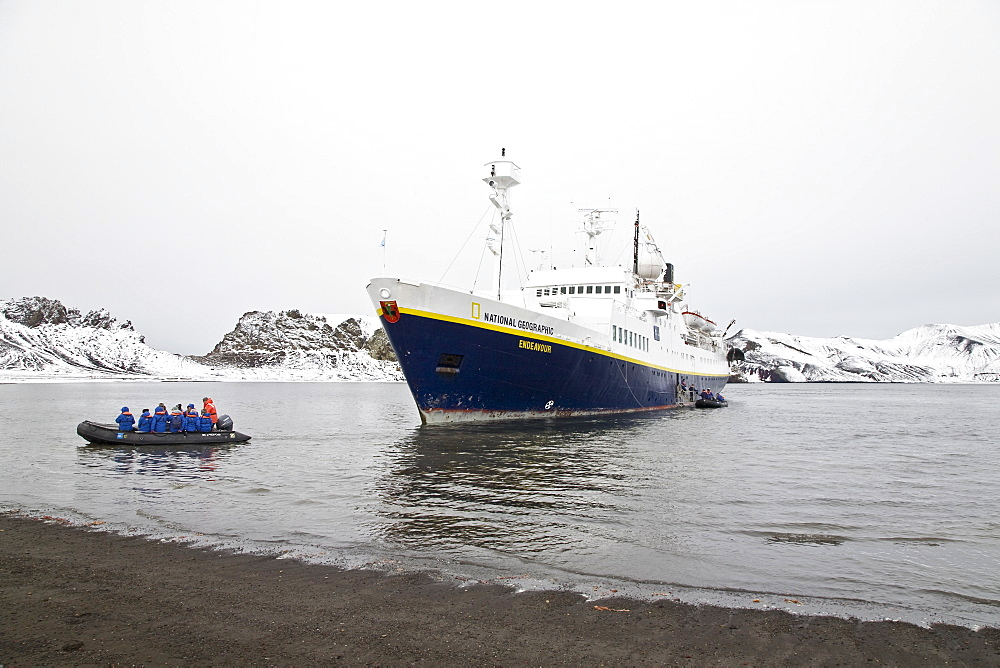 The Lindblad Expedition ship National Geographic Endeavour operating in Whalers Bay inside the caldera of Deception Island in the South Shetland Islands near the Antarctic peninsula in Antarctica. Lindblad Expeditions pioneered expedition travel for non-scientists to Antarctica in 1969 and continues as one of the premier expedition companies to travel to Antarctica even today.