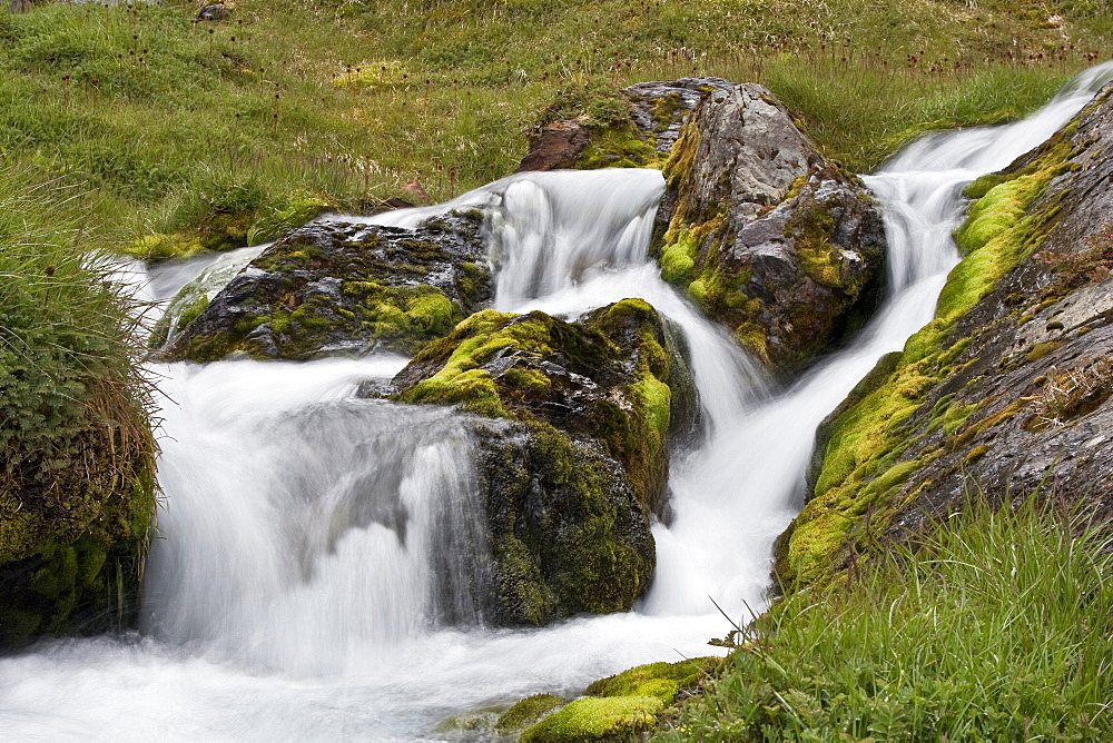 View of a small waterfall outside Grytviken (Swedish for 'Pot Cove'), the principal settlement in the United Kingdom territory of South Georgia in the South Atlantic. It was so named by a 1902 Swedish surveyor who found old English try pots used to render seal oil at the site. It is the best harbour on the island, consisting of a bay (King Edward Cove) within a bay (Cumberland East Bay). The site is very sheltered, provides a substantial area of flat land suitable for building on, and has a good supply of fresh water. The settlement at Grytviken was established on November 16, 1904, by the Norwegian sea captain Carl Anton Larsen as a whaling station for his Compañía Argentina de Pesca (Argentine Fishing Company).