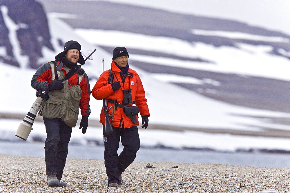 Natural history staff from the Lindblad Expedition ship National Geographic Explorer doing various things in and around the Svalbard Archipelago in the summer months. Lindblad Expeditions has run expeditions to Svalbard since the 1980's and remains one of the premier Arctic Expedition providers to this very day. No property or model releases are available for this image.