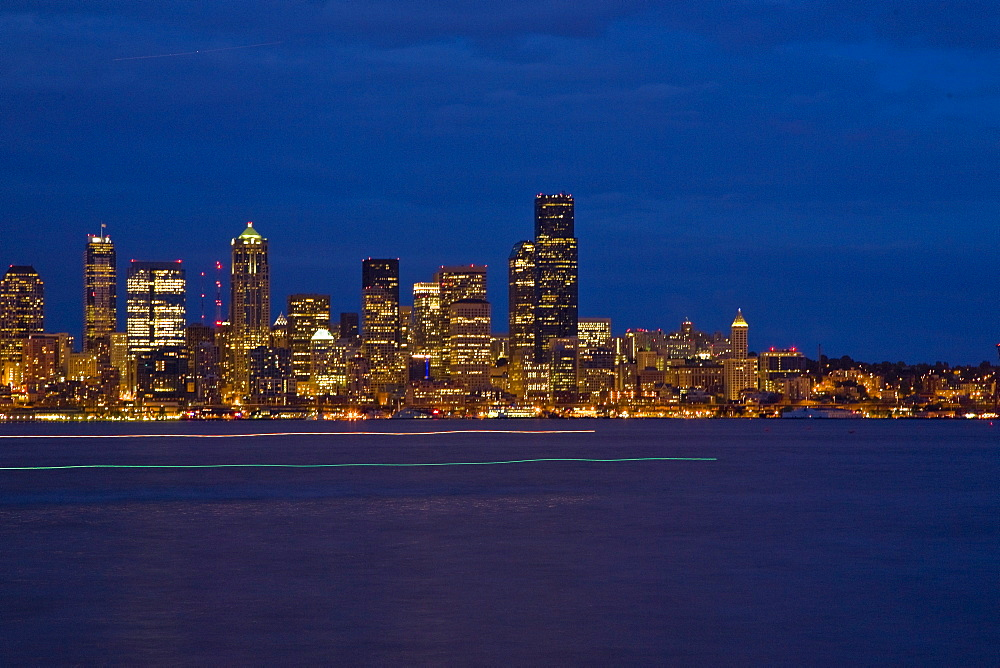 Views at night of downtown Seattle, Washington State, USA. Pacific Ocean.  No model or property releases are available for this image.