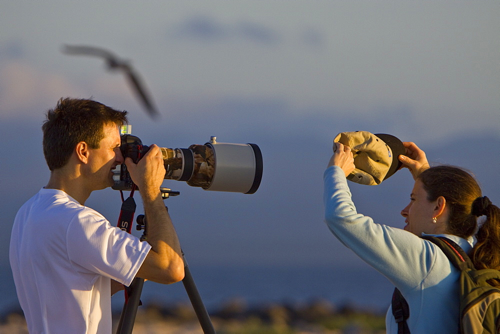 Lindblad Expeditions Guests working as a team to take phoptographs in the Galapagos Island Archipeligo, Ecuador. No model release available for this image.