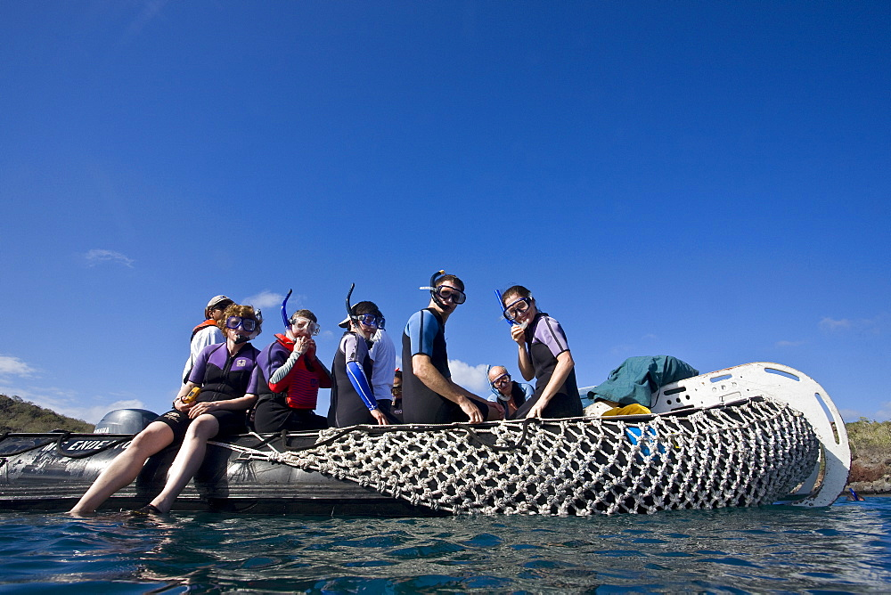 Lindblad Expeditions Guests preparing to snorkel in the Galapagos Island Archipeligo, Ecuador. No model or property releases available for tis image.