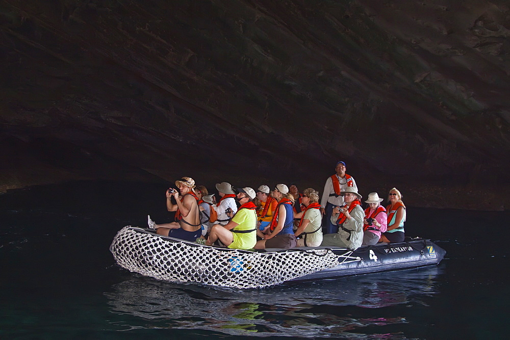 Lindblad Expeditions Guests exploring a sea grotto in the Galapagos Island Archipeligo, Ecuador. No model or property release are available for this image.