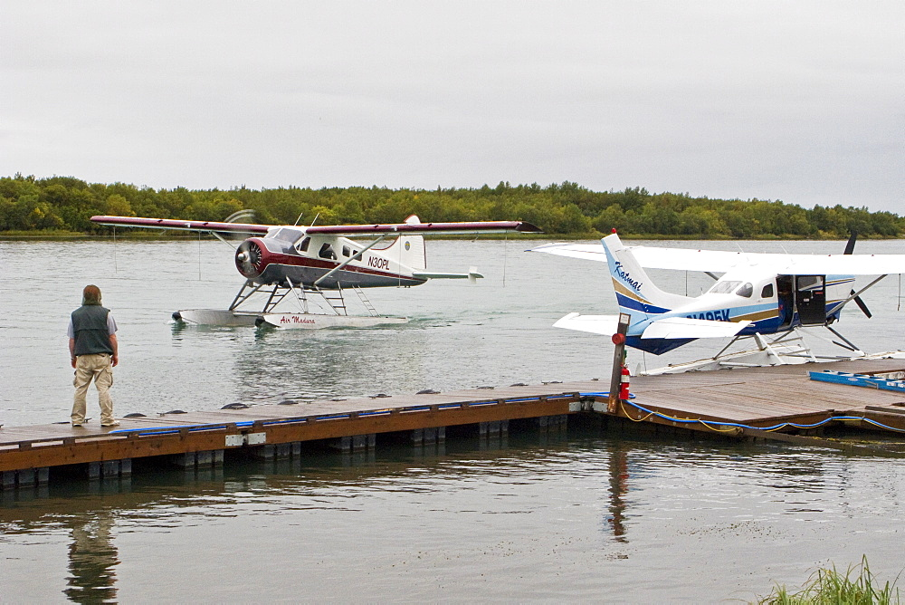 Small float planes being used to shuttle bear watchers between the town of King Salmon and a bear watching lodge at Brooks Camp in Katmai National Park, Alaska, USA. Pacific Ocean.