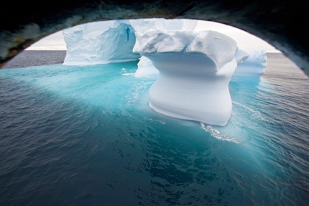 Iceberg detail in and around the Antarctic Peninsula during the summer months, Southern Ocean. MORE INFO An increasing number of icebergs is being created as climate change is causing the breakup of major ice shelves and glaciers. - 979-7446