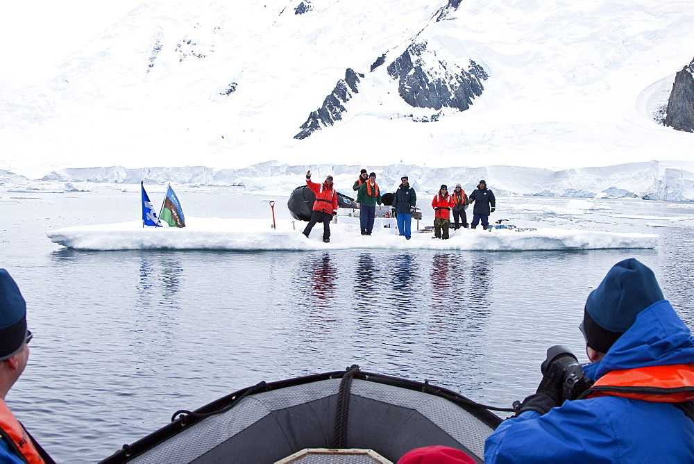 Guests from the Lindblad Expedition ship National Geographic Explorer enjoy a hot asado sandwich prepared by staff at BBQ on an ice floe near Adelaide Island, Antarctica. MORE INFO Lindblad Expeditions pioneered Antarctic travel in December 1969 and remai