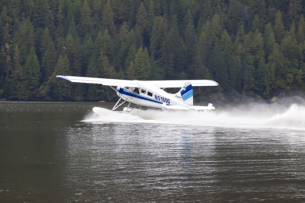 Float plane landing in Punchbowl, Misty Fjords National Monument, Southeast Alaska, USA, Pacific Ocean. MORE INFO Misty Fiords National Monument is a protected area administered by the United States Forest Service on the Pacific Ocean coast of North America, in extreme southeastern Alaska and covering 2,294,343 acres of Tongass National Forest in Alaska's Panhandle.