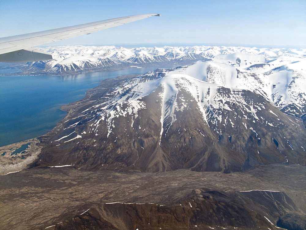 Aerial view of Spitsbergen, Svalbard, Norway. MORE INFO Svalbard is an archipelago in the Arctic Ocean north of mainland Europe, about midway between mainland Norway and the North Pole. It consists of a group of islands ranging from 748 to 818 north latitude, and from 108 to 358 east longitude. The archipelago is the northernmost part of Norway.