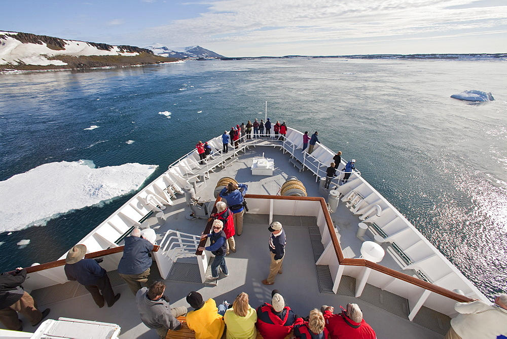 The National Geographic Explorer transits Heleysundet (Heley Sound). Heleysundet is a narrow sound between K÷kenthalîya and Spitsbergen. MORE INFO It was discovered (and named) by the 60-ton ship John Ellis in 1617, which had been sent out by the Muscovy Company to explore to the south-eastwards of Spitsbergen. The sound was named after the Englishman William Heley (b. 1594/95), a supercargo and vice-admiral of the English whaling fleet from 1617 to 1623.