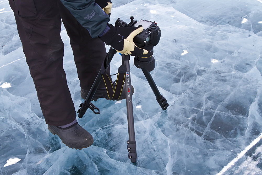 Canadian photographer Gilles Pucheu at work near his home in Yellowknife, Northwest Territories, Canada. MORE INFO Model release number GP032810.