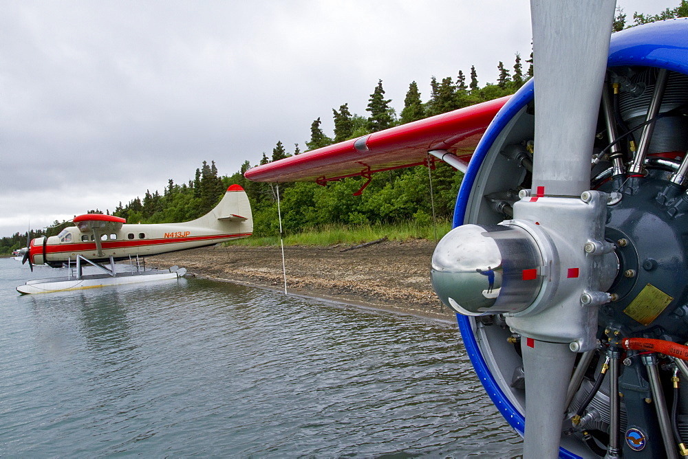 Float planes used to fly guests in to the Brooks Lodge and campground in Katmai National Park near Bristol Bay, Alaska, USA. Pacific Ocean. MORE INFO Every July salmon spawn in the river between Naknek Lake and Brooks Lake and brown bears and people congregate near the falls to catch them as they swim upstream. A float plane or small boat is the only way to get to this remote section of the Katmai National Park.