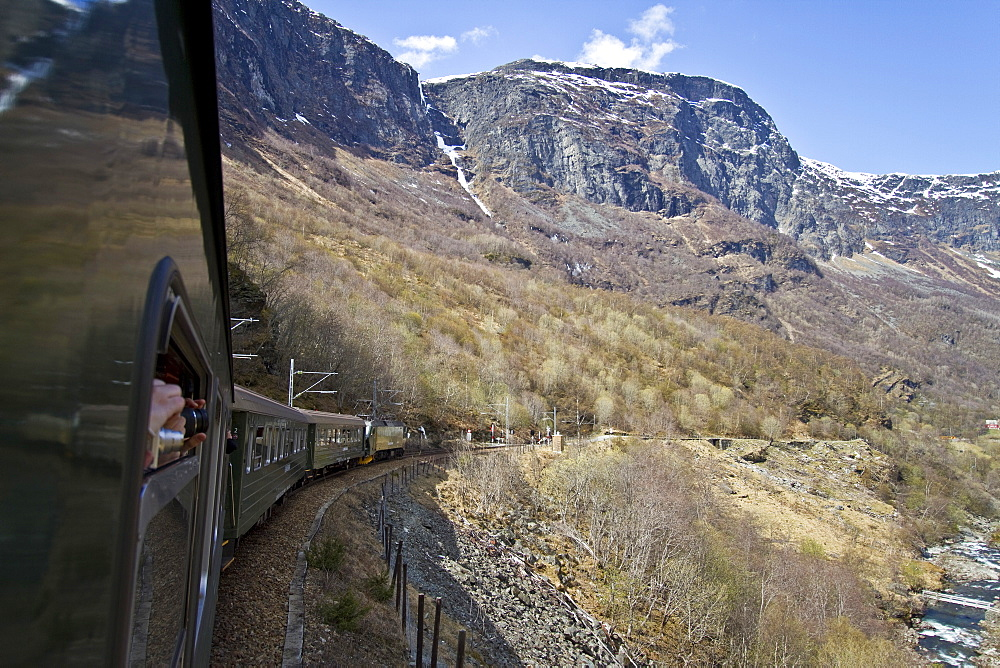 Views from the Bergen Railway route from Myrdal to the town of Fl†m, Norway.  MORE INFO The Fl†m Railway descends more than 2900 feet in less than one hour from Myrdal to Fl†m. Fl†m is a Norwegian village with some 500 inhabitants, at the inner end of the Aurlandsfjord, an arm of the Sognefjord. age of Fl†m is a popular tourist destination and has been so since the late 19th century. It currently receives almost 450,000 visitors a year.