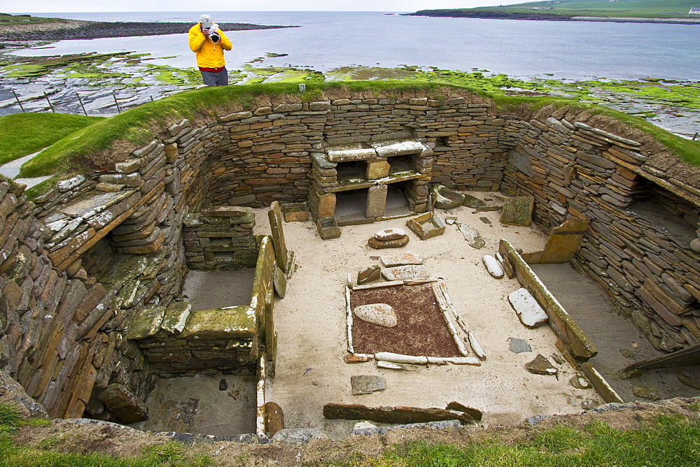 Skara Brae, a Neolithic village constructed in 3,100 BC, Orkney Islands, Scotland. MORE INFO Skara Brae was lived in for over 600 years before it is believed to have been abandoned. Amazingly preserved and all made of stone, the now roofless dwellings reveal beds, dressers, storage boxes, and hearths.