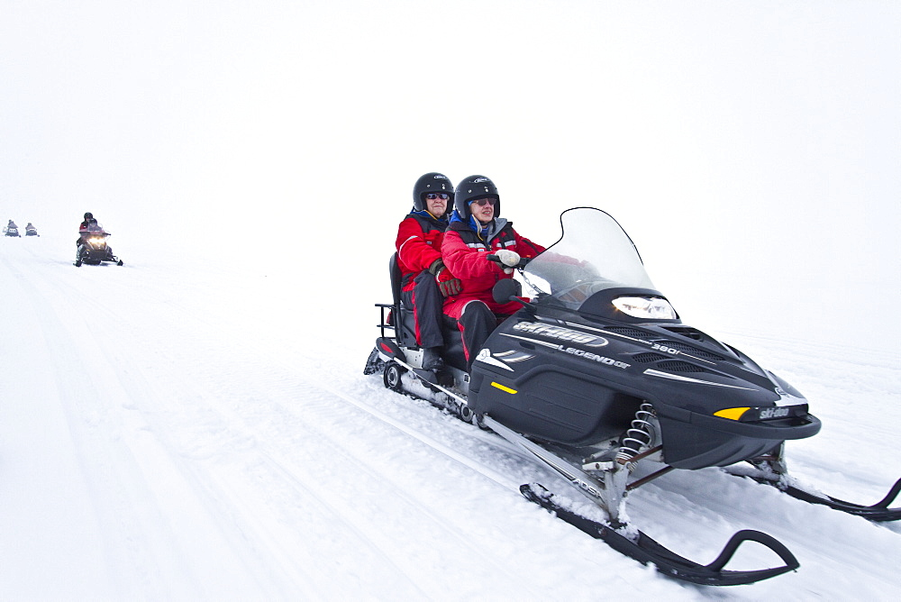 Snowmobiling on the Vatnajskull ice cap, Iceland. MORE INFO  The Vatnajskull ice cap is the largest glacier in Europe in volume and the second largest (after Austfonna on Nordaustlandet, Svalbard) in area.
