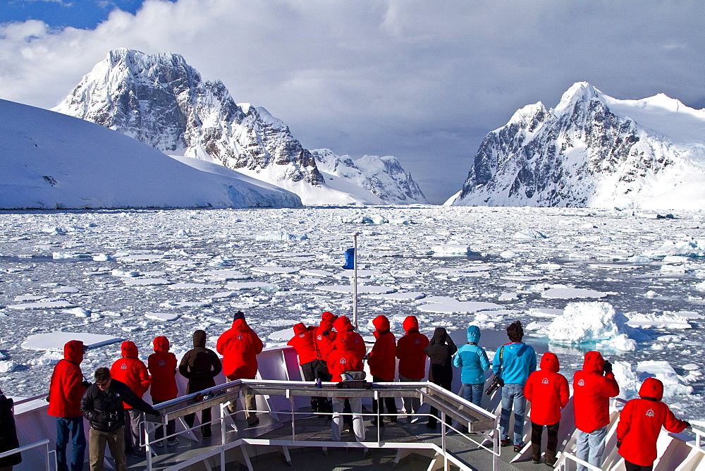 Guests from the Lindblad Expedition ship National Geographic Explorer enjoy the Lemaire Channel in Antarctica