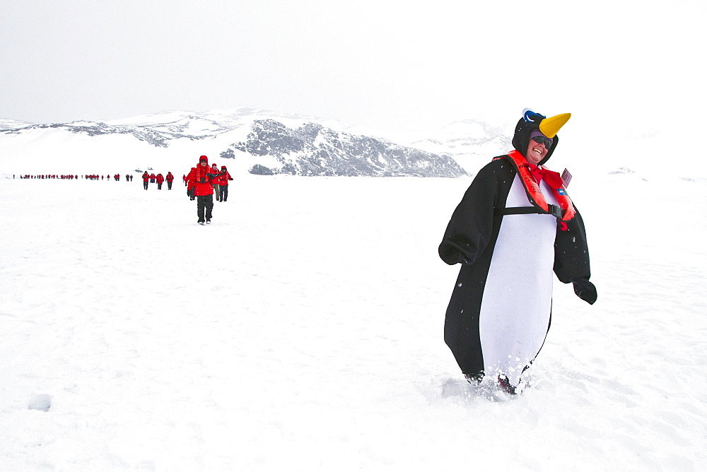 Bartender Jamie dressed as a penguin from the Lindblad Expedition ship National Geographic Explorer enjoy Antarctica. MORE INFO Lindblad Expeditions pioneered Antarctic travel in December 1969 and remains one of the premier Antarctic Expedition providers to this very day.