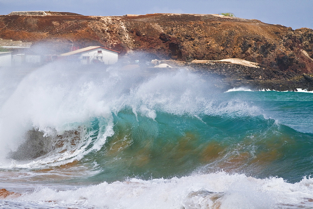 HUGE waves breaking on the beach at Ascension Island in the Tropical Atlantic Ocean. MORE INFO  Ascension Island is a remote volcanic island in the tropical waters of the South Atlantic Ocean. It is located roughly 1,000 miles from the coast of Africa and