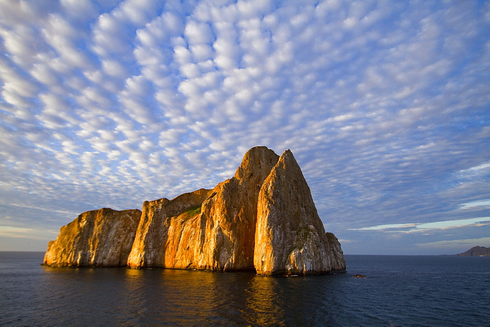 Scenic view of Leon Dormido (Sleeping Lion) Island off San Cristobal Island in the Galapagos Island Archipelago, Ecuador. MORE INFO This small island is a popular SCUBA diving site known for sharks, turtles and rays.