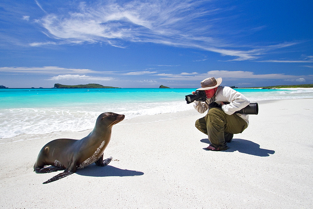 Staff (shown here is National Geographic photographer Joel Sartore) from the Lindblad Expedition ship National Geographic Endeavour in the Galapagos Islands, Ecuador. MORE INFO Lindblad Expeditions has been active in the Galapagos since the 1990's and has raised several million dollars towards conservation and education in the Galapagos.