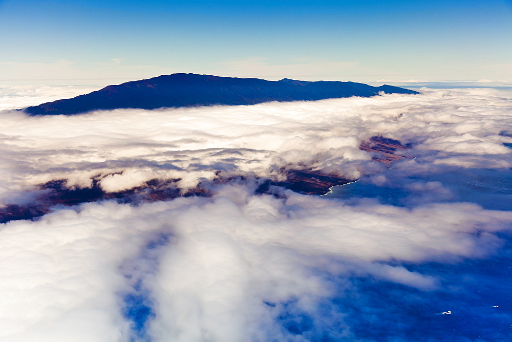Haleakala or the East Maui Volcano, elevation of 10,023 ft (3,055 m), standing above massive clouds, Maui, Hawaii, USA - 983-555