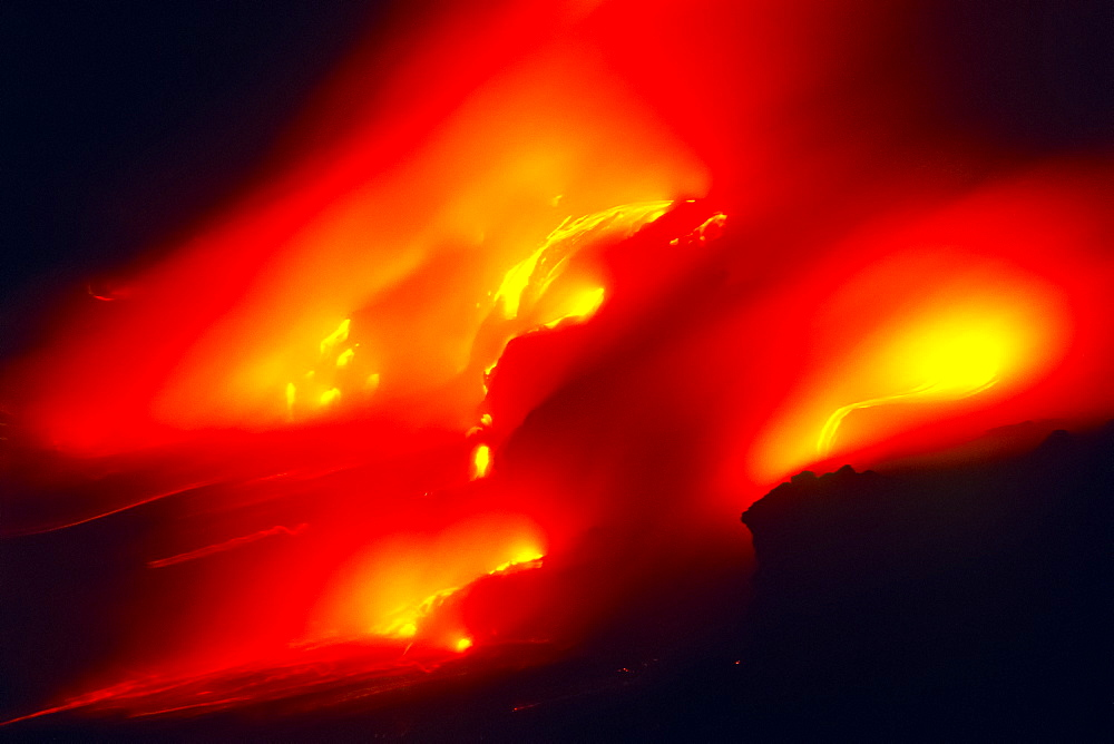 lava ocean entry - new land are violently created by countless hydromagnetic explosions as hot molten lava flows into the Pacific Ocean, Hawaii Volcanoes National Park at night, Kilauea, Big Island, Hawaii, USA - 983-579