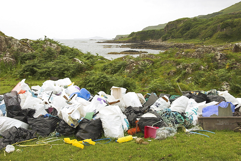 Piles of rubbish collected from beach beyond, Torloisk beach, Isle of Mull, Scotland   (RR)
