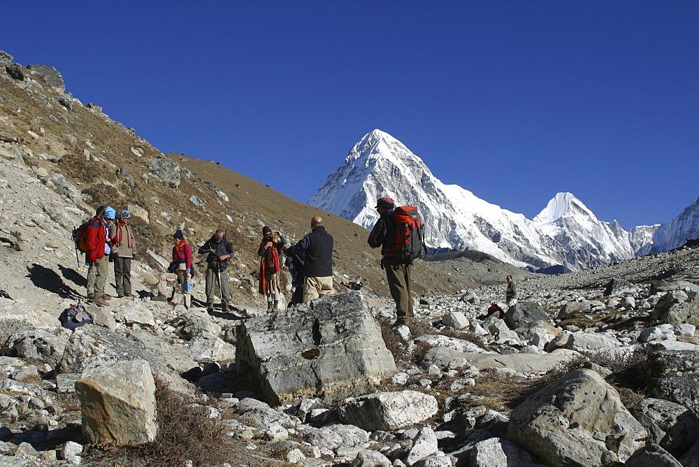 Trekkers Nr Everest. On the Low Kumbu Glacier, Nepal - 986-77