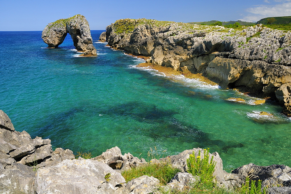 Castro de Gaviotas (Gull's fort) karst limestone rock archway, and La Canalina bay, near Llanes, Asturias, Spain, Europe