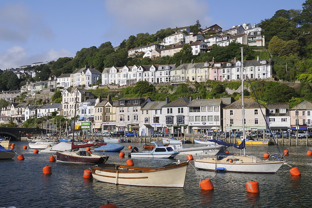 Fishing boats and sailing yachts moored in Looe harbour, Cornwall, England, United Kingdom, Europe