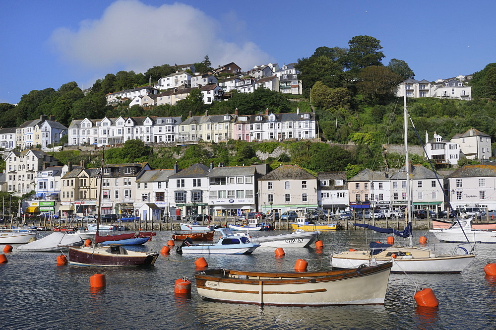 Sailing yachts and fishing boats moored in Looe harbour, Cornwall, England, United Kingdom, Europe