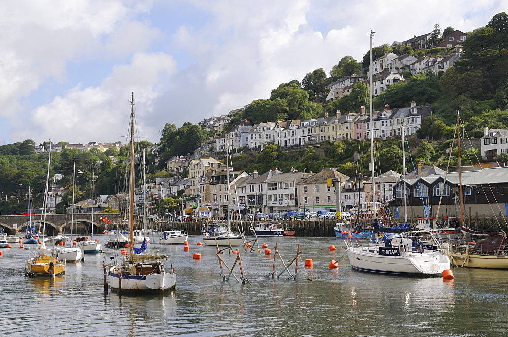 Sailing yachts, pleasure boats and fishing boats moored in Looe harbour, Cornwall, England, United Kingdom, Europe