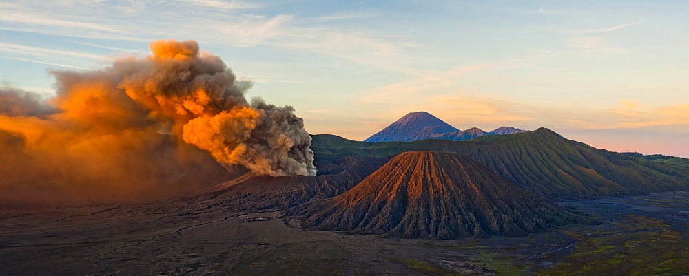 Mount Bromo (Gunung Bromo), an active volcano, erupting at sunrise throwing up ash clouds, East Java, Indonesia, Southeast Asia, Asia