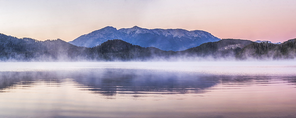 Misty sunrise at Nahuel Huapi Lake (Lago Nahuel Huapi), Villa la Angostura, Neuquen, Patagonia, Argentina, South America