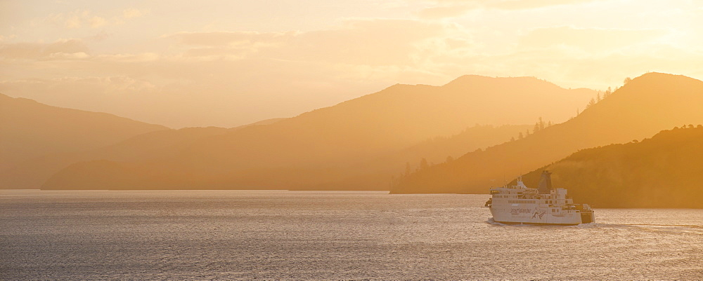 Queen Charlotte Sound at sunset, the Interislander ferry between Picton, South Island and Wellington, North Island, New Zealand, Pacific