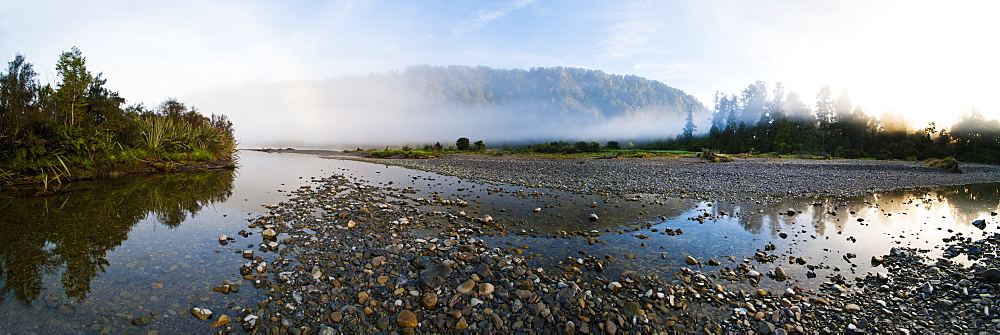Mist on the Waitangitanoa River at sunrise, Westland National Park, UNESCO World Heritage Site, on the West Coast of South Island, New Zealand, Pacific