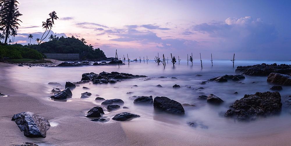 Stilt fishermen at sunrise, Midigama near Weligama, South Coast, Sri Lanka, Indian Ocean, Asia