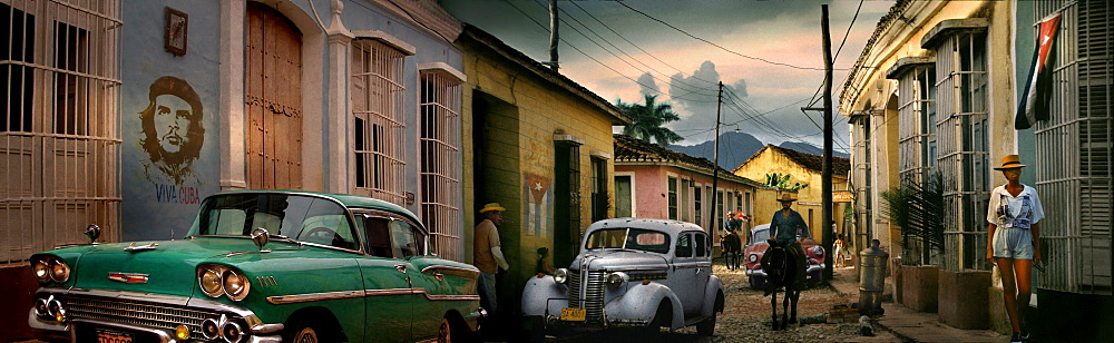 Street scene with oldtimer, horse and Che Guevara wall painting, Trinidad, Sancti Spiritus, Cuba, Carribean, North America, America
