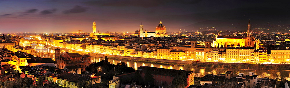 Panorama of illuminated Florence with the Ponte Vecchio bridge, Palazzo Vecchio, cathedral Santa Maria del Fiore and San Croce, Florence, UNESCO world heritage site, Tuscany, Italy