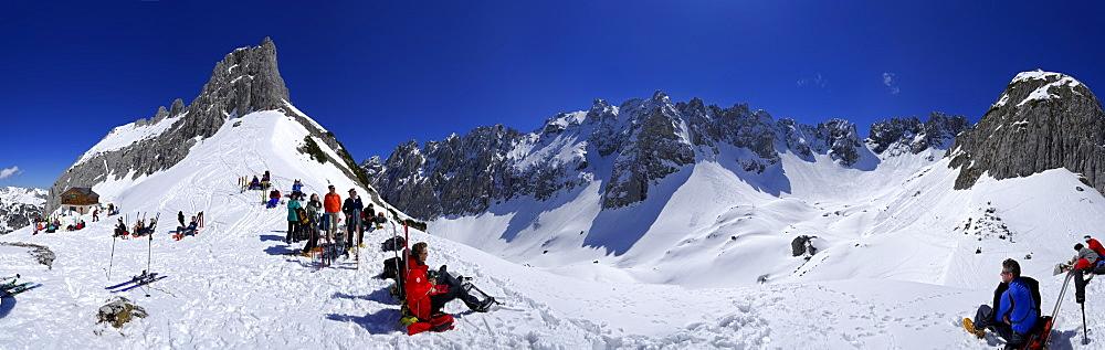 Groups of backcountry skiers resting near Fritz-Pflaum lodge, Griesner Kar, Wilder Kaiser, Kaiser range, Tyrol, Austria