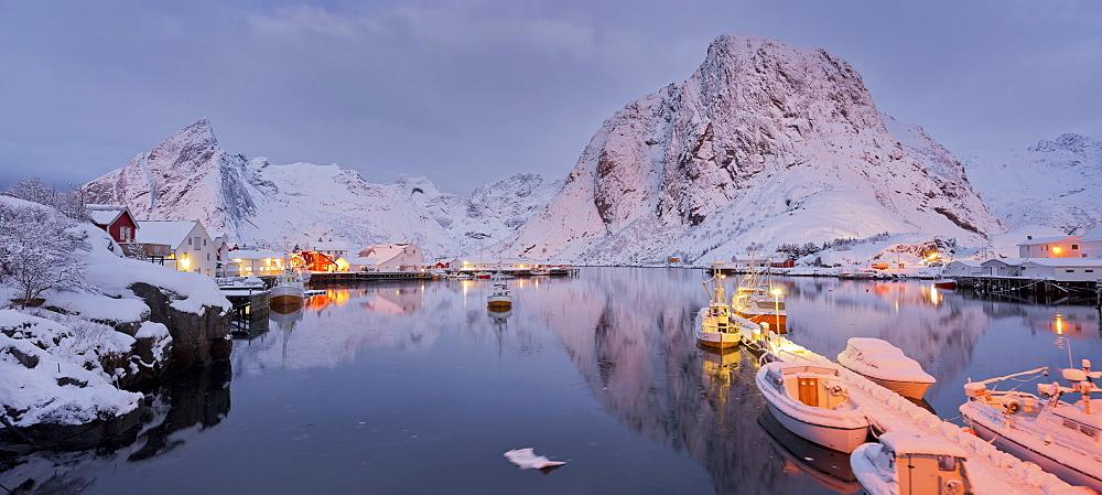Hamnoy in the evening light, reflection in the water, Reine, Moskenesoya, Lofoten, Nordland, Norway