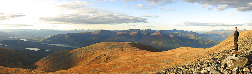 Person standing on Keno Hill overlooking Wernecke Mountains, Yukon