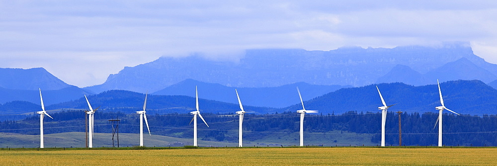 Wind turbines with Rocky Mountains in background, Pincher Creek, Alberta