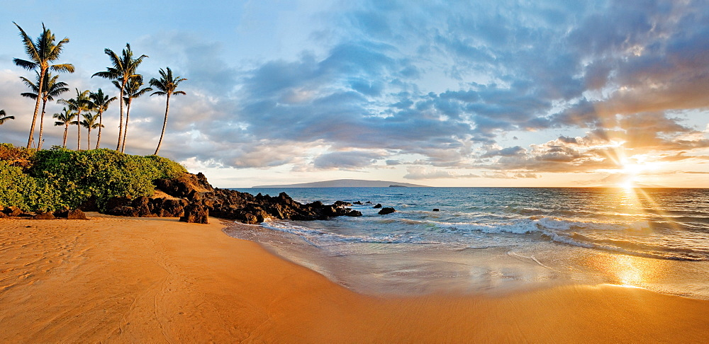 Hawaii, Maui, Makena, Secret Beach at sunset.
