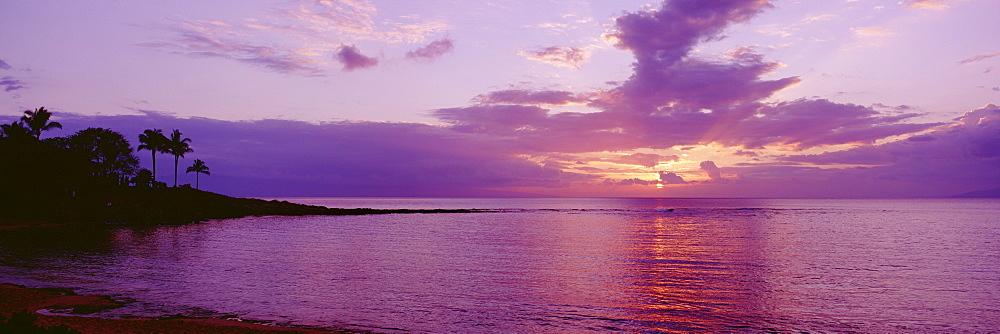 Hawaii, Maui, Kapalua Beach, Purple sunset over ocean.