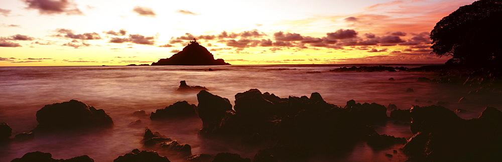 Hawaii, Maui, Hana, View of Alau Island from Hana shore at sunrise.