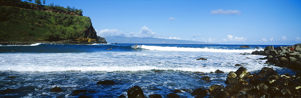 Hawaii, Maui, Honokahau coast, Surfers on waves close to shore.