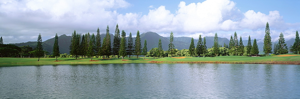 Hawaii, Kauai, Princeville Resort Golf Course, Lakes Course 18th hole, view from across water, panoramic