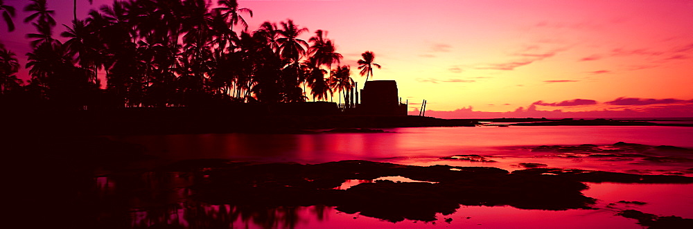 Hawaii, Big Island, Kona, Pu'uhonua O Honaunau (Place of Refuge) at sunset, panoramic .